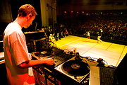 DJ mixing music with a MC performing and audiences in the background. UK B-Boy championships 06. 08/10/2006