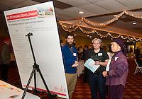Rueben Bassett, Bree Henderson and MaryEllen Boudman share ideas for Economic Development during Re Imagine Laconia at the Opechee Conference Center Wednesday evening.  (Karen Bobotas Photographer)