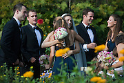 Ariana Rockefeller and Mathew Bucklin (right) greet guests after their wedding ceremony on Mount Desert Island, Maine, Saturday, September 4, 2010.  Craig Dilger for The New York Times