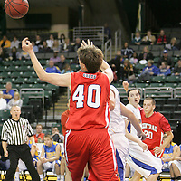 Forward Thomas Schmittdiel (40) reaches for the rebound.