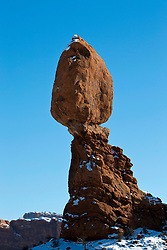 Balanced Rock during a winter morning with snow on the ground, Arches National Park, Utah, United States of America