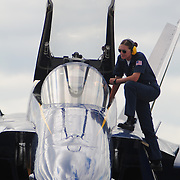 September 7, 2008 -- NAS BRUNSWICK, Maine. Plane Captain for Blue Angel Five, U.S. Navy Avation Ordnanceman 2nd Class Alisha Raper gives final confirmation to her pilot, Lt. Cmdr. Craig Olson at the The Great State of Maine Airshow on Sunday. The airshow came to Naval Air Station Brunswick for the last time this weekend, bringing The U.S. Navy Blue Angels, The U.S. Army Golden Knights and a wide variety of static displays and interactive exhibits. The show drew over 150,000 people over three days with no mishaps among the performers and no emergencies among the attendees. .Because NAS Brunswick is scheduled to be closed in 2011 by the Base Realignment Commission, there will not be another Navy-sponsored airshow at this location. Yet, the Local Redevelopment Authority, responsible for managing the property after the departure of the Navy,  has included an airshow on a list of possible future uses for the property.  U.S. Navy Photo by Mass Communication Specialist 1st Class Roger S. Duncan (RELEASED)