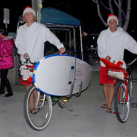 Surfing Santas Lars Rathe 23, (left) and Kai Werring, 24, promote the new  Santa Monica mobile app for the iPhone, iPod Touch and Android devices during the annual Montana Avenue Holiday Walk on Friday, December 3, 2010.