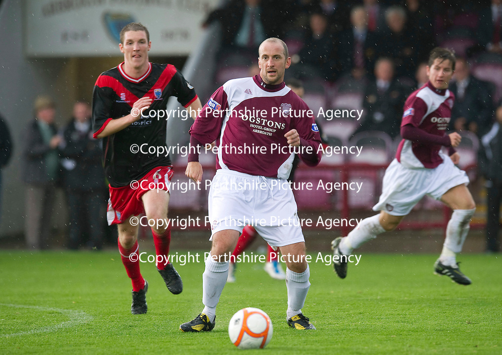 Arbroath v Airdrie Utd...17.09.11   <br /> Paul sheerin closed down by Sean Lynch<br /> Picture by Graeme Hart.<br /> Copyright Perthshire Picture Agency<br /> Tel: 01738 623350  Mobile: 07990 594431