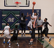 McNeil's Trae Dilworth attempts a basket against Cedar Ridge Friday at McNeil.  The Mavs beat the Raiders 66-56 in overtime.  (LOURDES M SHOAF for Round Rock Leader).