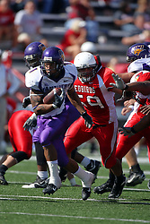 29 September 2007: Corey Lewis bolts from the pack with Bill Hronec in pursuit. In action between the Northern Iowa Panthers and the Illinois State Redbirds, the Panthers chewed up the Redbirds by a score of 23 - 13. Game action commenced at Hancock Stadium on the campus of Illinois State University in Normal Illinois..