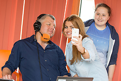 © Licensed to London News Pictures . 11/08/2015 . Merseyside , UK . ADRIAN CHILES posing for selfie with young carers KATIE (20) and JAMIE (15) . BBC Radio 5 Live broadcast live from Clock View mental health Hospital in Merseyside . Photo credit : Joel Goodman/LNP