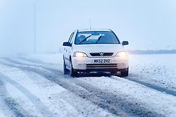 © Licensed to London News Pictures. 27/12/2014. Horseshoe Pass, Denbighshire, UK. Despite the bad weather conditions motorists climb the mountain pass. Snow continues to fall on high ground in Wales.<br />   Photo credit: Graham M. Lawrence/LNP