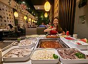 China, Sichuan. Chengdu. Anita Lai in her family's stylish restaurant Juji Dalong Hotpot 聚极大龙火锅.