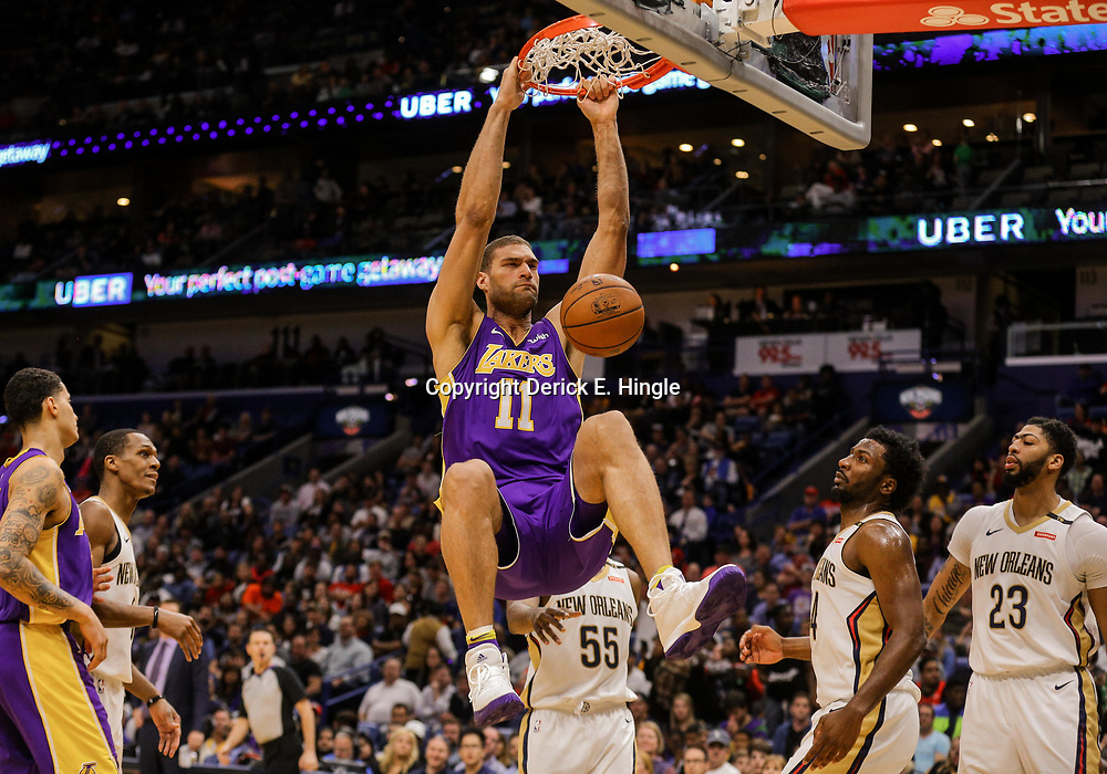 Mar 22, 2018; New Orleans, LA, USA; Los Angeles Lakers center Brook Lopez (11) dunks over New Orleans Pelicans forward E'Twaun Moore (55) and forward Solomon Hill (44) and forward Anthony Davis (23) during the second quarter at the Smoothie King Center. Mandatory Credit: Derick E. Hingle-USA TODAY Sports