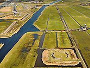 Nederland, Zuid-Holland, Gemeente Leiderdorp, 20-02-2012; Polder Achthoven met zicht op de ingang van de boortunnel onder het Groene Hart van de hogesnelheidslijn (HSL-Zuid), met bedieningsgebouw van de tunnel, voorbeeld 'landschappelijke inpassing'. Onder in beeld luchtschacht van de tunnel die de drukgolf van de treinen opvangt. In de polder verder twee watermolens..View of  Polder Achthoven with entrance to the drilled tunnel of the High Speed ​​Line (HSL) under so-called the Green Heart, with the control building of the tunnel, example of 'landscaping'..Bottom of the screen the air shaft of the tunnel that enables the pressure wave of the trains to escape..luchtfoto (toeslag), aerial photo (additional fee required).copyright foto/photo Siebe Swart