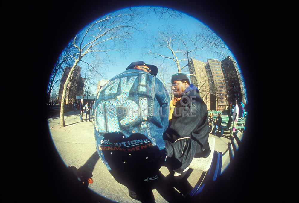 Fisheye view of Africa Bambaataa wearing denim jacket, Central Park, New York, U.S.A, 1980s.