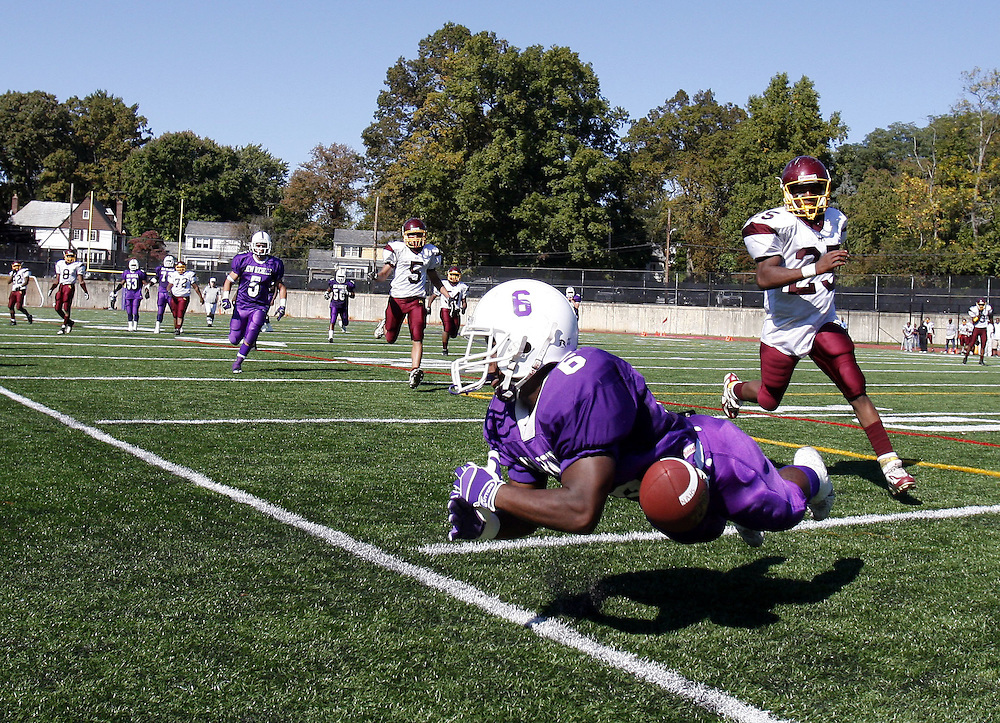 New Rochelle wide receiver Xavier Walker dives for this pass during a varsity football game between New Rochelle and Mount Vernon at New Rochelle High School Oct. 11, 2008.  New Rochelle won the game 14-6.  ( Mike Roy / The Journal News )