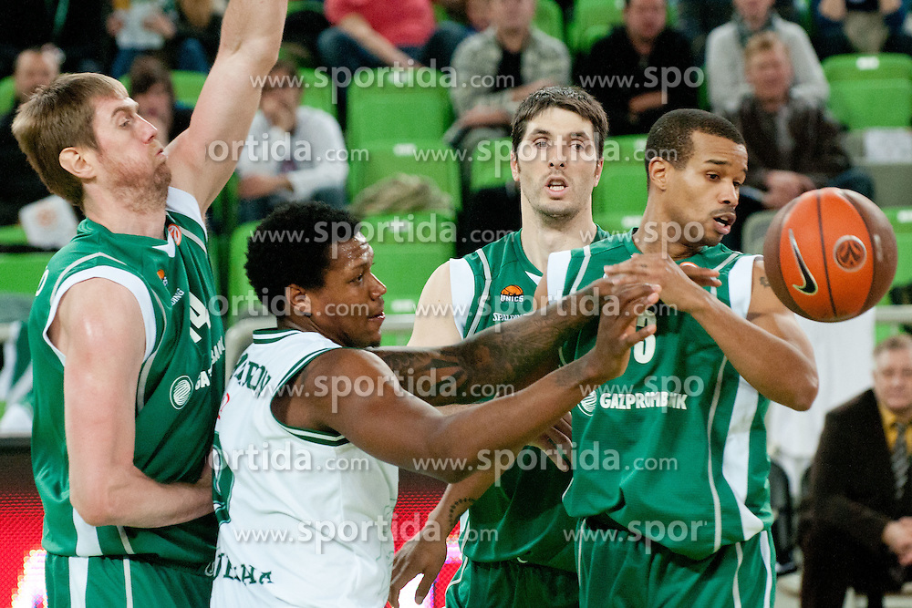 Deon Thompson of Union Olimpija vs Aleksey Savrasenko of Unics Kazan and Lynn Greer of Unics Kazan during basketball match between KK Union Olimpija and Unics Kazan (RUS) of 10th Round in Group D of Regular season of Euroleague 2011/2012 on December 21, 2011, in Arena Stozice, Ljubljana, Slovenia. Unics Kazan defeated Union Olimpija 76:63.(Photo by Matic Klansek Velej / Sportida)