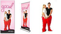 advertising photograph for weight loss and diets. Picture features 2 ladies fitting into the lady who has lost weights old trousers/ Proud of how much weight she has lost on a diet