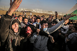 March 22, 2019 - Gaza City, The Gaza Strip, Palestine - Palestinian protesters east of Gaza city during friday clashes, Gaza health ministry said Israeli forces kill two Palestinians at Gaza protests 62 also wounded. (Credit Image: © Abed Alrahman Alkahlout/Quds Net News via ZUMA Wire)