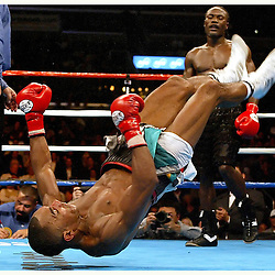 Lovemore N' Dou (Black Trunks) Junior Witter (White Trunks) for British Commonwealth Super Lightweight Championship at the Staples Center in Los Angeles February 19. 2005. Junior Witter flips after winning the title in 12 rounds.