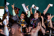 Students from the Scripps College of Communication cheer as their college is announced during the commencement ceremony Saturday May 3, 2014.  Photo by Ohio University / Jonathan Adams