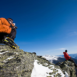 Ty Wivell photographs climbing guide Paul Cormier on Mount Clay above the Great Gulf in New Hampshire's White Mountains.  Winter. Northern Presidential mountain range.  Gulfside Trail.