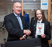 14 December 2018: Somercotes Academy.<br /> Isobel Russell (Year 9) who designed the winning Tollbar MAT<br /> Christmas Card. She is pictured receiving her prize from Chief Executive Officer David Hampson.<br /> Picture: Sean Spencer/Hull News & Pictures Ltd<br /> 01482 210267/07976 433960<br /> www.hullnews.co.uk         sean@hullnews.co.uk