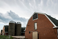 Historic old Dairy Barn as storm clouds come in.