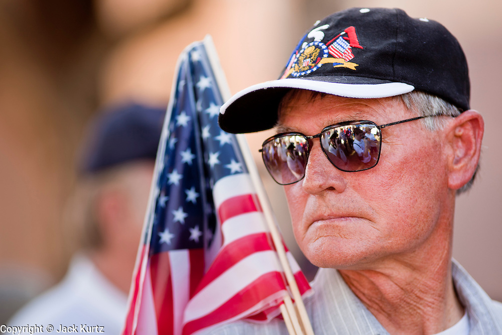 15 APRIL 2011 - PHOENIX, AZ: A Tea Party supporter with American flags at the Arizona State Capitol in Phoenix, AZ, Friday. About 500 supporters of the Tea Party movement rallied Friday at the Arizona State Capitol to mark tax day. They protested high taxes, the federal deficit, the debt limit and immigration policy. About 50 pro-immigrant protesters held a counter rally at the capitol. At least one person was arrested, and others led away by police after several shouting matches between Tea Party supporters and the immigrants rights protesters broke out.     Photo by Jack Kurtz