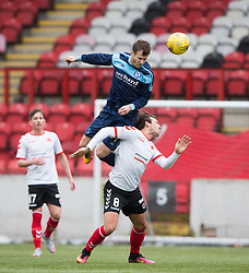 Forfar Athletic's Danny Denholm over Clyde's Matthew Flynn. half time : Clyde 0 v 1 Forfar Athletic, Scottish League Two game played 4/3/2017 at Clyde's home ground, Broadwood Stadium, Cumbernauld.