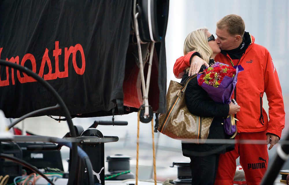 14FEB09. PUMA Ocean Racing Leg 5 start of the Volvo Ocean Race 2008-2009 from Qingdao to Rio de Janeiro. Valentine's Day kiss for wife Kathy as the boat leaves the dock.