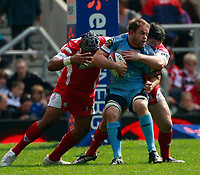 Photo: Richard Lane/Richard Lane Photography. Gloucester Rugby v Cardiff Blues. Anglo Welsh EDF Energy Cup Final. 18/04/2009. Blues' Xavier Rush is tackled by Gloucester's Akapusi Aera and Oliver Azam.