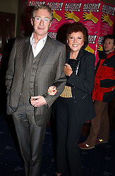 Comedian PAUL O'GRADY and CILLA BLACK at an after show party following the opening night of Acorn Antiques - The Musical at The Theatre Royal, Haymarket and held at The Cafe de Paris, Coventry Street, London on 10th February 2005.<br />