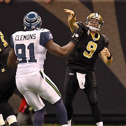 November 21, 2010; New Orleans, LA, USA; New Orleans Saints quarterback Drew Brees (9) is pressured by Seattle Seahawks defensive end Chris Clemons (91) during a game against the Seattle Seahawks at the Louisiana Superdome. Mandatory Credit: Derick E. Hingle
