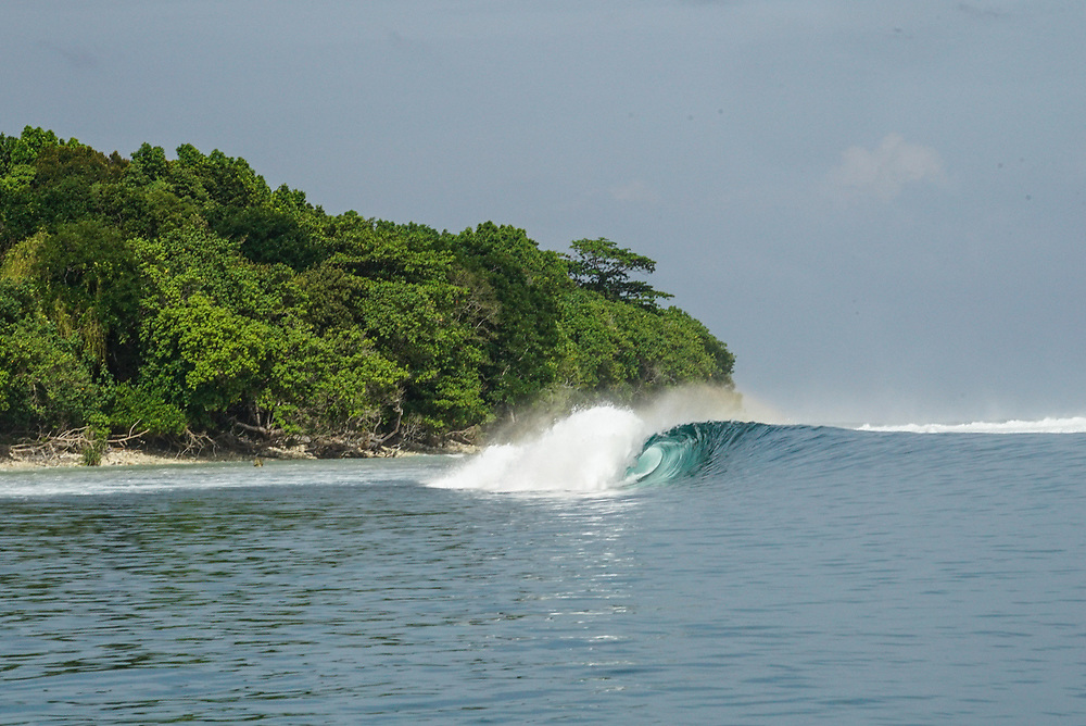 One of the best waves of indonesia , Onepalm point.Panaitan is an island in the Sunda Strait, between Java and Sumatra, and in the Indonesian province of Banten. It is the largest island in the strait, and is located near the westernmost tip of Java.Panaitan's hills rise from pristine forest with wild life comprised of deer, wild board, monkey, bulls, large monitor lizar, black leopard, phyton and a wide variety of bird life. This beautiful tropical island is the background of one the most incredible surf spot in the world class waves in warm, clear blue water and away from crowds.