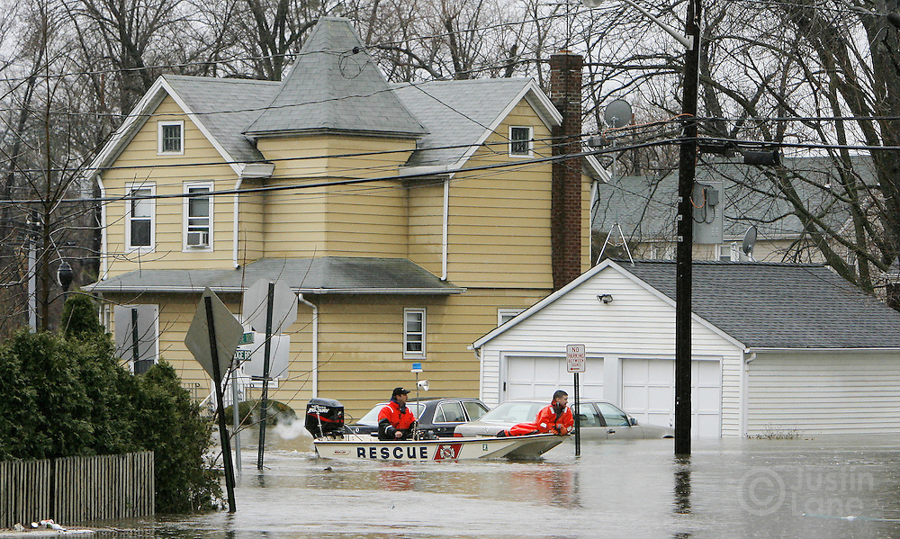 A rescue boat patrols a flooded neighborhood in Teaneck, New Jersey on Monday 16 April 2007. A large storm delivered records amount of rain to the East Coast of the United States over the weekend and today, causing New Jersey to declare a state of emergency.