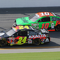 Sprint Cup Series driver Jeff Gordon (24) and Sprint Cup Series driver Danica Patrick (10) race during the 57th Annual NASCAR Coke Zero 400 practice session at Daytona International Speedway on Friday, July 3, 2015 in Daytona Beach, Florida.  (AP Photo/Alex Menendez)