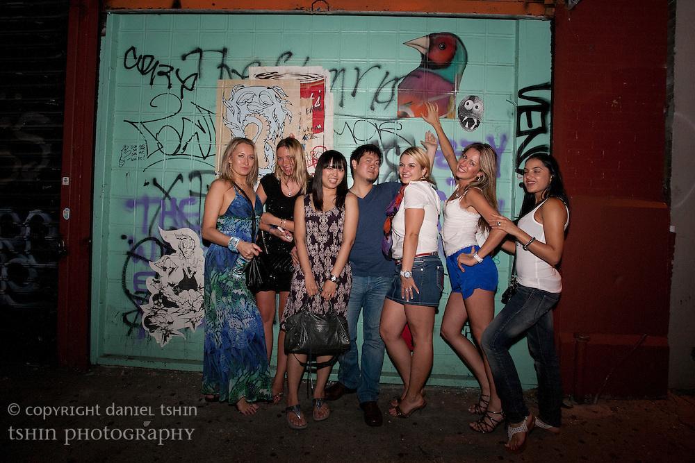 Portraits against a graffiti'd wall