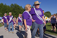 Pine Bush, New York - People from the Pine Bush community participate in the Survivors Walk during the Pine Bush Relay for Life on Saturday, June 7, 2014. The Relay for Life is the American Cancer Society's largest fundraising event. ©Tom Bushey / The Image Works
