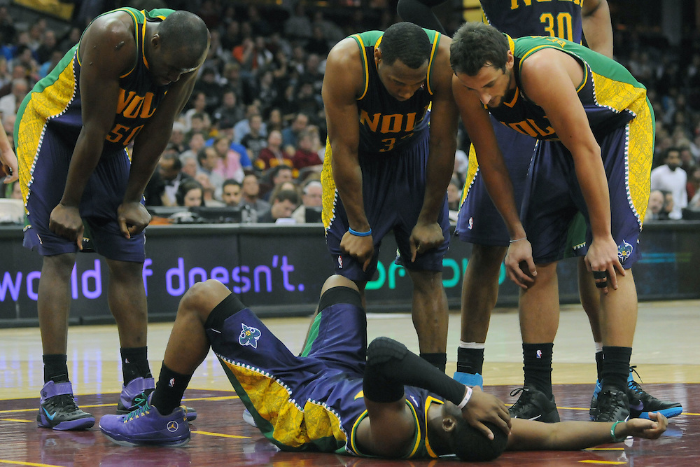 March 6, 2011; Cleveland, OH, USA; New Orleans Hornets point guard Chris Paul (3) is surrounded by his teammates after taking a hard fall during the third quarter against the Cleveland Cavaliers at Quicken Loans Arena. New Orleans Hornets point guard Chris Paul (3) was taken out of the game. Mandatory Credit: Jason Miller-US PRESSWIRE