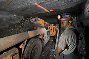 Jackie Ray Clem operating a Joy Continuos Reach mining machine at the Stillhouse 2 Coal Mine, in Harlan County, Kentucky. The Joy Continuos Reach cuts an eleven foot wide swath of coal.