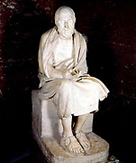 Herodotus (c485-425 BC) Greek historian, often called the Father of History. Statue of seated man said to be Herodotus. Louvre, Paris