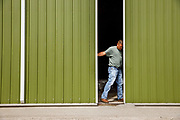 Soybean and corn farmer Ryan Mickelson closes the door to an equipment shed Friday, June 22, 2018, on their farm near Duncombe, Iowa. (Scott Morgan/ for The Guardian)