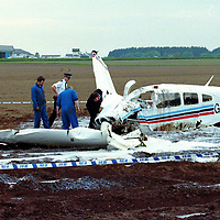 Air crash...27.5.99.<br />Police and crash investigators at the scene of the air crash with the Scone Airfield buildings in the background.<br /><br />Picture Copyright:  John Lindsay / Perthshire Picture Agency.<br />Tel. office 01738 623350. mobile 07775 852112