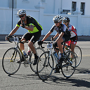 El Tour de Tucson 2017 finishers rounding the race's final corner at 22nd Street and 6th Avenue. Bike-tography by Martha Retallick.