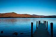 A jetty at Ashness Landing at sunrise on Derwent Water, Lake District National Park, Cumbria, UK