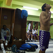 'Attitude at Altitude' Football in Potosi, Bolivia'..The Real Potosi team prepare in the dressing room before the match between Real Potosi and Wilstermann at the The Estadio Victor Agustin Ugarte, Potosi, Bolivia, Real Potosi won the match 3-0. 2nd May 2010. Photo Tim Clayton..'Attitude at Altitude' Football in Potosi, Bolivia'..The Calvario players greet the final whistle with joyous celebration, high fives and bear hugs the players are sprayed with local Potosina beer after a monumental 3-1 victory over arch rivals Galpes S.C. in the Liga Deportiva San Cristobal. The Cup Final, high in the hills over Potosi. Bolivia, is a scene familiar to many small local football leagues around the world, only this time the game isn't played on grass but a rock hard earth pitch amongst gravel and boulders and white lines that are as straight as a witches nose, The hard surface resembles the earth from Cerro Rico the huge mountain that overlooks the town. .. Sitting at 4,090M (13,420 Feet) above sea level the small mining community of Potosi, Bolivia is one of the highest cities in the world by elevation and sits 'sky high' in the hills of the land locked nation. ..Overlooking the city is the infamous mountain, Cerro Rico (rich mountain), a mountain conceived to be made of silver ore. It was the major supplier of silver for the spanish empire and has been mined since 1546, according to records 45,000 tons of pure silver were mined from Cerro Rico between 1556 and 1783, 9000 tons of which went to the Spanish Monarchy. The mountain produced fabulous wealth and became one of the largest and wealthiest cities in Latin America. The Extraordinary riches of Potosi were featured in Maguel de Cervantes famous novel 'Don Quixote'. One theory holds that the mint mark of Potosi, the letters PTSI superimposed on one another is the origin of the dollar sign...Today mainly zinc, lead, tin and small quantities of silver are extracted from the mine by over 100 co operatives and private mining co