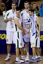 Vladimir Golubovic (21) of Olimpija, Sani Becirovic (7) of Olimpija, Uros Slokar (15) of Olimpija and Saso Ozbolt (31) of Olimpija at basketball match of 4th Round of NLB League between KK Union Olimpija and KK Crvena zvezda,  on October 24, 2009, Arena Tivoli, Ljubljana, Slovenia.  Union Olimpija won 94:76.  (Photo by Vid Ponikvar / Sportida)
