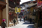 People walk past guest houses and shops in the old town of Shangri-la, which has been developed for tourism.
