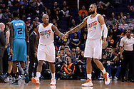 Jan 6, 2016; Phoenix, AZ, USA; Phoenix Suns forward P.J. Tucker (17) and center Tyson Chandler (4) high five on the court against the Charlotte Hornets at Talking Stick Resort Arena. Mandatory Credit: Jennifer Stewart-USA TODAY Sports