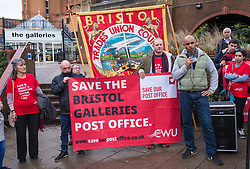 © Licensed to London News Pictures. 01/12/2018. Bristol, UK. Bristol's elected Mayor MARVIN REES speaks at the Save Our Post Offices campaign event at Bristol's main post office which under threat of closure in The Galleries Shopping Centre. Members of the Communication Workers Union (CWU) supported by Bristol Trades Union Council were joined by Bristol's elected Mayor Marvin Rees to campaign against the proposed closure. This is part of a national campaign day, Saturday 01 December, to save Crown Post Offices from closure. Bristol's main Post Office in The Galleries shopping centre is on the list of regional closures along with the main Post Offices in Bath and Gloucester, with services due to be transferred to post office counters in branches of WH Smiths under a franchise arrangement. And in Kingswood the post office which moved to WH Smith last year would transfer to be operated directly by WH Smiths with Post Office workers becoming Smiths' employees. It is feared while fully trained Post Office counter staff should be moved across and retain their £12-an-hour salaries, any new staff would be employed by WHSmith at the minimum wage. The campaign has been launched by the CWU in response to the announcement that 74 Crown offices are to be franchised (privatised) to high-street retailer WH Smith – a move which will impact some 800 jobs and drastically cut services to communities. Photo credit: Simon Chapman/LNP