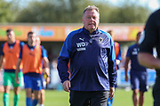 AFC Wimbledon manager Wally Downes walking off the pitch during the EFL Sky Bet League 1 match between AFC Wimbledon and Shrewsbury Town at the Cherry Red Records Stadium, Kingston, England on 14 September 2019.