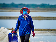 28 MARCH 2018 - BAN LAEM, PHETCHABURI, THAILAND: A worker in a salt field during the 2018 salt harvest in Petchaburi province, about two hours south of Bangkok. Sea salt is made in provinces south of Bangkok by flooding fields with ocean water after the rainy season. As the fields dry out from evaporation, workers go into the fields and gather the salt left behind.  PHOTO BY JACK KURTZ